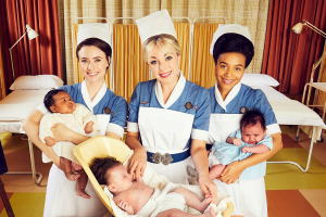 Main characters holding babies.